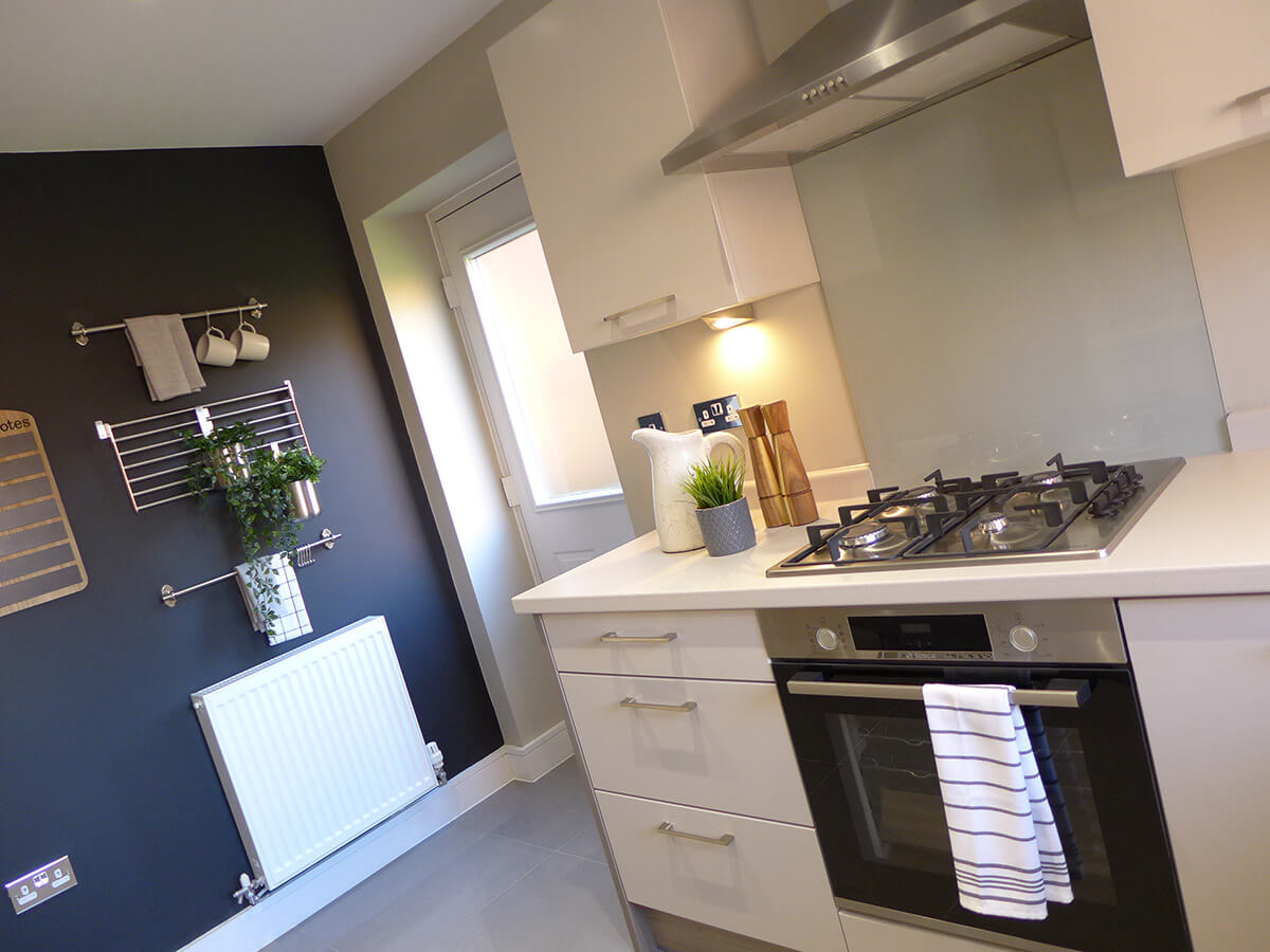 kitchen with integrated appliances and door to garden