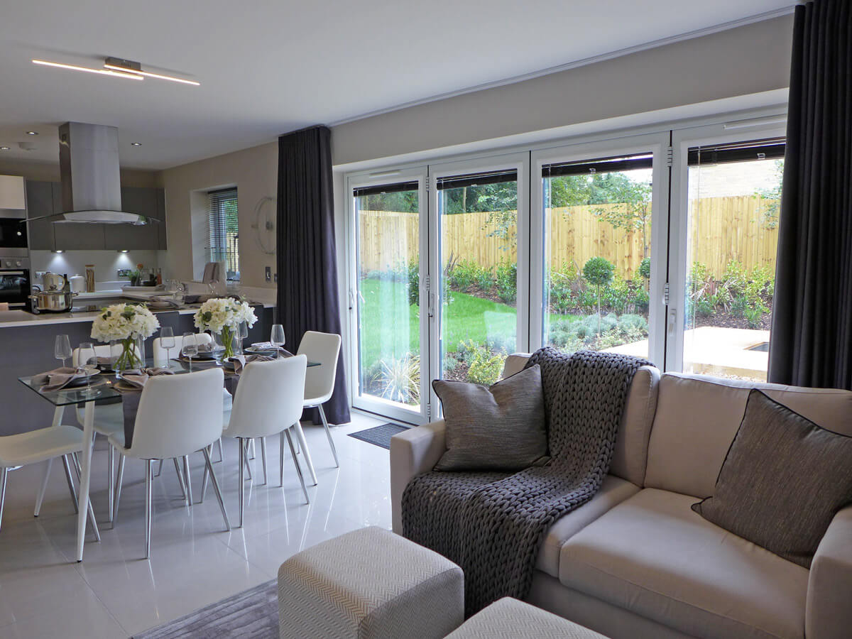 Dining and family area with bi fold doors to garden