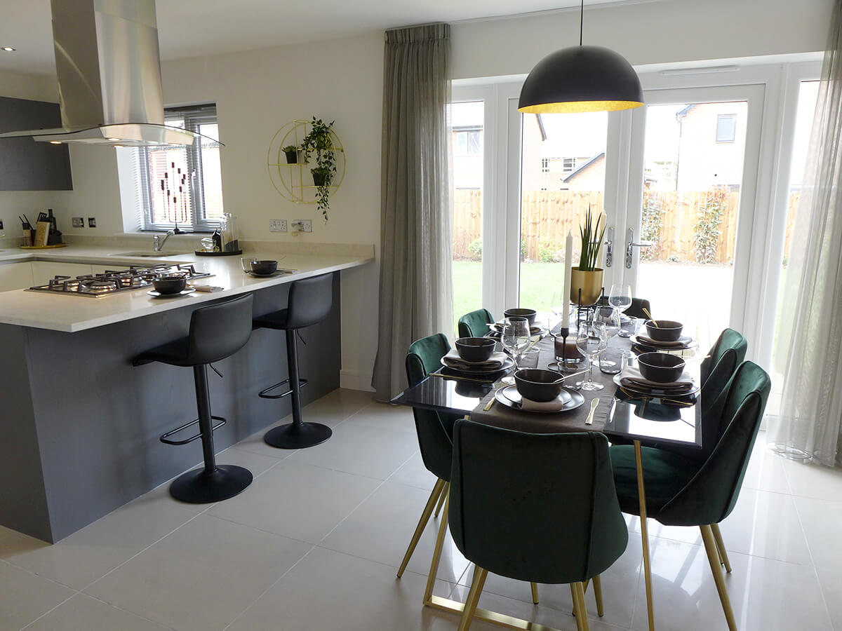 Example kitchen and dining area with French doors to garden
