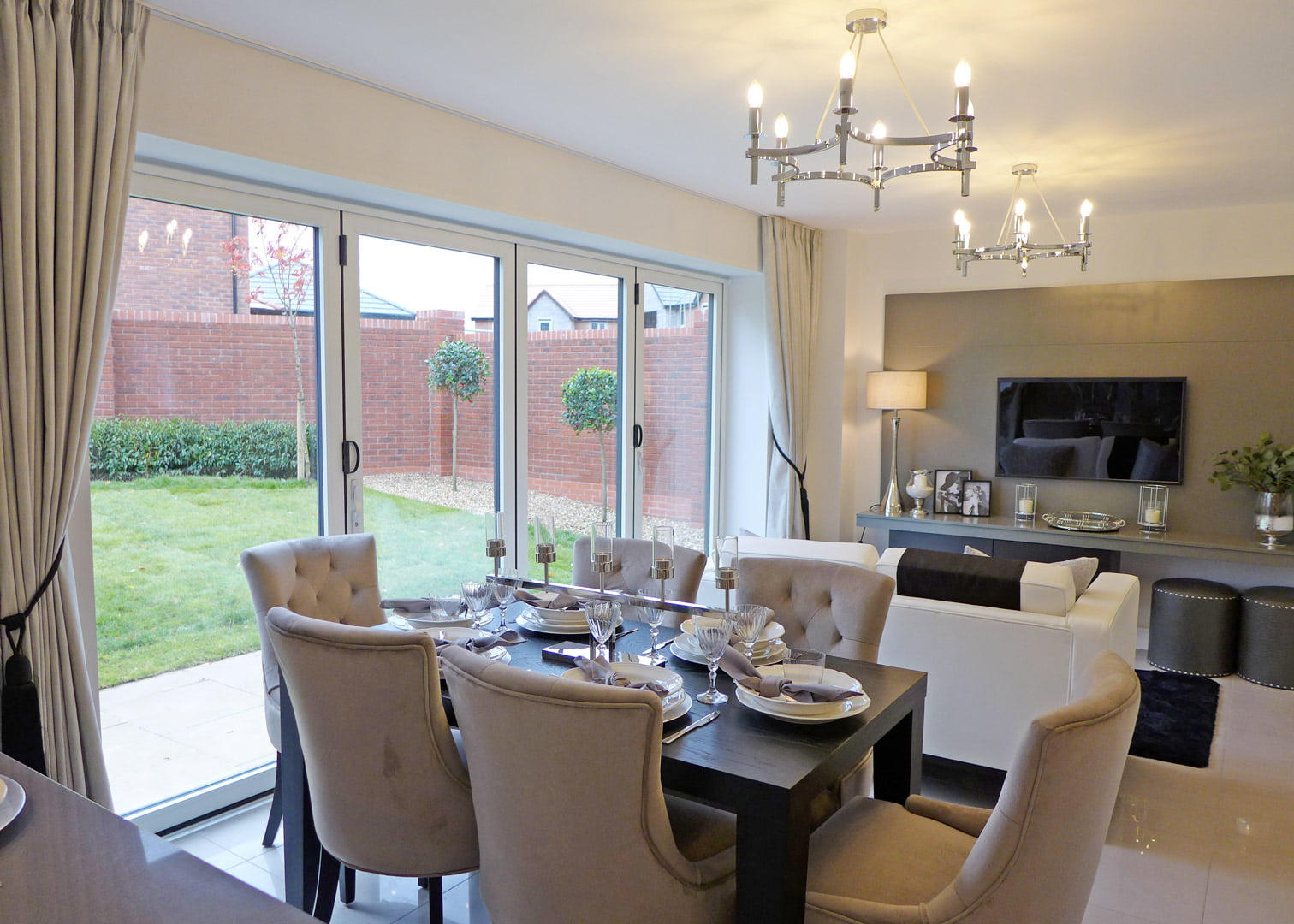 Example dining and family area with bi fold doors to garden